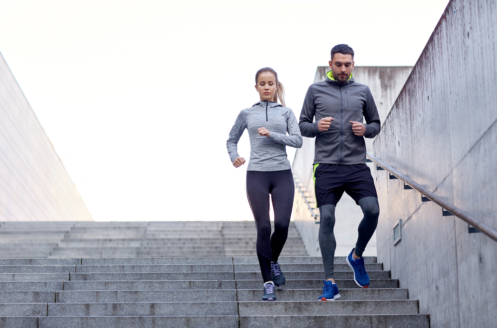 man and woman running down the stairs